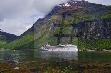 Norwegian Star in front of the impressive mountains in Geirangerfjord © #tamme wichmann photography
