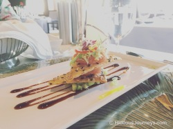 Appetizer: Spicy Ahi Tuna Tower on Parmesan Black Sesame Tuile with cucumber and avocado medley